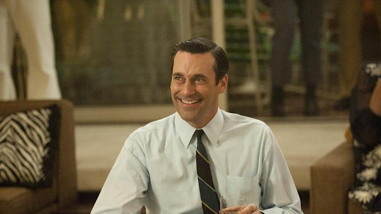 "In this publicity photo released by AMC, Jon Hamm as Don Draper is shown in Season 5, Episode 1, of ""Mad Men."" The nominations for the 64th Primetime Emmy Awards are announced on Thursday, July 19, 2012. ""Mad Men"" is making a bid at Emmy Awards history to win its fifth best drama series trophy. (AP Photo/AMC, Ron Jaffe)"