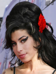 FILE in this June 3, 2007, file photo British singer Amy Winehouse arrives at the MTV Movie Awards in Los Angeles. The family of Amy Winehouse has put the late singer's London home up for sale for 2.7 million pounds ($4.2 million).The three-bedroom property in the Camden neighborhood of northwest London had become a shrine of sorts for mourning fans who left flowers and tributes following Winehouse's death last July from alcohol poisoning. A spokesman for the Winehouse family, said Thursday May 31, 2012 that the singer had loved the house and her family put it on the market because they felt it would be inappropriate for any of them to live there. (AP Photo/Kevork Djansezian, File)