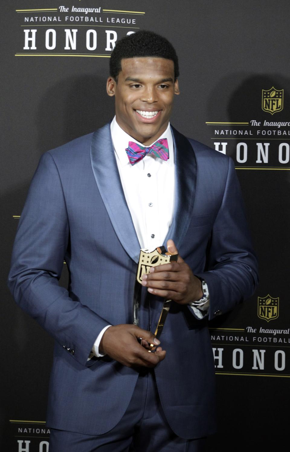Carolina Panthers' Cam Newton holds the  AP Offensive Rookie of the Year trophy during the inaugural NFL Honors show Saturday, Feb. 4, 2012, in Indianapolis.The New York Giants will face the New England Patriots in the NFL football's Super Bowl XLVI in Indianapolis on Feb. 5. (AP Photo/Darron Cummings)