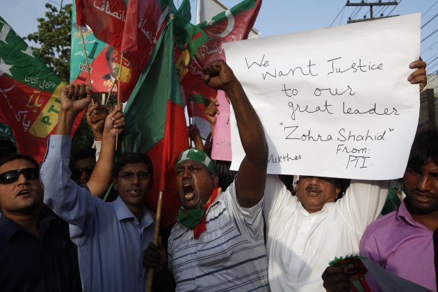 Supporters of the PTI political party protest against the killing of Hussain, a leading member of the PTI, in Lahore