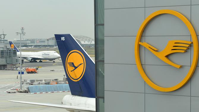 FILE - In this Sept. 12, 2013 file picture a Boeing 747-400 of German airlines Lufthansa stands at the airport in Frankfurt, Germany. The global airlines industry still expects a record profit for 2014, just not quite as high as previously forecast due to the impact of rising jet fuel prices, officials said Wednesday March 12, 2014. But the cost of fuel isn't the only challenge. Venezuela's decision to block airlines from taking profits out of the country, the Ukrainian political crisis and a vanished Malaysian jetliner are adding uncertainty to the outlook, said Tony Tyler, director-general and CEO of the International Air Transport Association. (AP Photo/dpa,Arne Dedert,File)