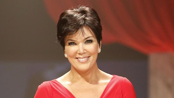 """FILE - This Feb. 6, 2013 file photo shows Kris Jenner at the Red Dress Collection 2013 Fashion Show in New York. The studio behind Kris Jenner's new daytime talk show says it will launch the program in July. Twentieth Television said Thursday that the show, titled """"Kris,"""" will air for six weeks starting July 15 on selected Fox-owned stations. Those will include stations in New York and Los Angeles, with more to be announced later. Jenner is the matriarch of the media clan that includes daughters Kourtney, Kim and Khloe Kardashian. (Photo by John Minchillo/Invision/AP, file)"""