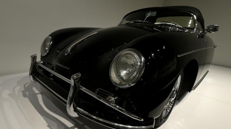 In this photo taken Wednesday, Oct. 9, 2013 a 1958 Porsche Type 356 Speedster 1600 Super once owned by Steve McQueen is shown on display in the Porsche By Design Seducing Speed exhibit at the North Carolina Museum of Art in Raleigh, N.C. (AP Photo/Gerry Broome)