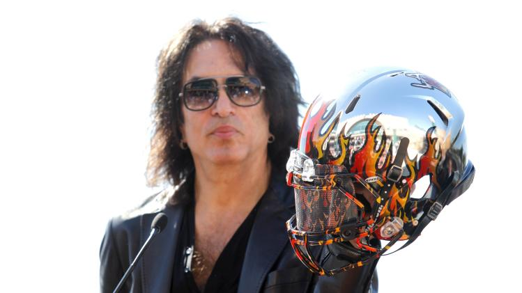Musician Paul Stanley of rock band KISS holds a helmet which players for Arena Football League team, the Los Angeles Kiss, will wear during a news conference in Anaheim