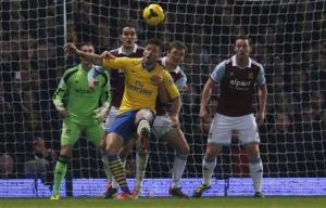 Arsenal's Giroud challenges West Ham United's O'Brien and West Ham United's McCartney during their English Premier League soccer match at Upton Park in London