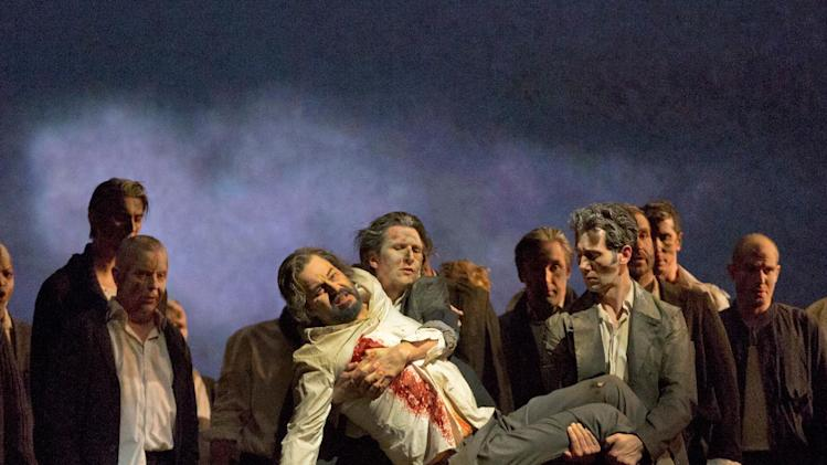 """In this Feb. 8, 2013 photo provided by the Metropolitan Opera, Peter Mattei performs as Amfortas in Wagner's """"Parsifal,"""" during a dress rehearsal at the Metropolitan Opera in New York. When Mattei agreed to debut the role at the Met, he was known mostly as a Mozart singer, and the only Wagner he had sung was the lyrical Wolfram in """"Tannhaeuser."""" At first, Mattei confided, """"I was a little nervous to do it. Wolfram for me was spot on, but I knew Amfortas was a step up dramatically. (AP Photo/ Metropolitan Opera, Ken Howard)"""