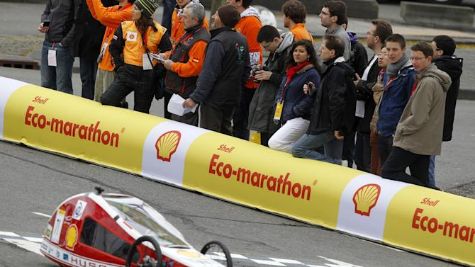 IMAGE DISTRIBUTED FOR SHELL - Fans watch The Autonomie III, vehicle No. 7, Prototype, running on Diesel, competing for team GMP Valenciennes from IUT GMP Valenciennes, France, race on Day 1 of competition during the Shell Eco-marathon Europe at The Ahoy centre in Rotterdam, The Netherlands on Friday, May 17, 2013. Teams from universities all over Europe have brought their energy efficient cars to compete in the challenge. (Bas Czerwinski/AP Images for Shell)