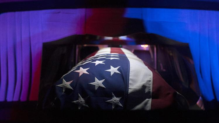 The casket of U.S. Army Sgt. Joseph Gantt is rests inside a hearse at Los Angeles International Airport
