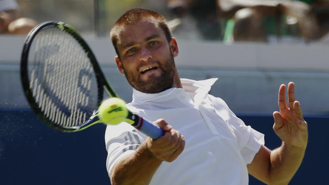 On edge of default, Kyrgios advances at US Open