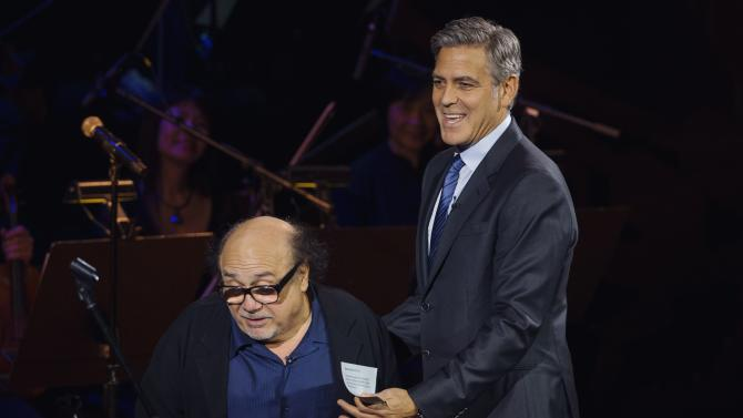 "Actor George Clooney shoos actor Danny DeVito off the stage while speaking at ""An Evening of SeriousFun Celebrating the Legacy of Paul Newman"" event in New York"