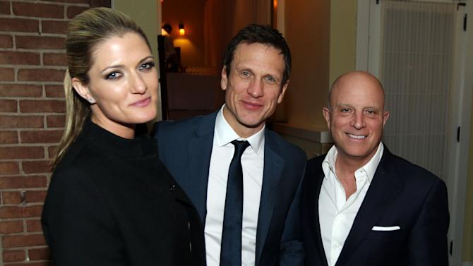"Chris Albrecht, chief executive of STARZ, right, Simon Merrells, center, and Montana Coady Albrecht pose together at the after party for the premiere of ""Spartacus: War of the Damned"" on Tuesday, Jan. 22, 2013 in Los Angeles. ""Spartacus: War of the Damned"" premieres Friday, Jan. 25 at 9PM on STARZ. (Photo by Matt Sayles/Invision for STARZ/AP Images)"
