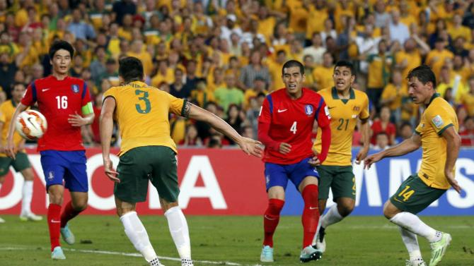 Australia's James Troisi shoots to score a goal against South Korea during extra time of their Asian Cup final soccer match at the Stadium Australia in Sydney J