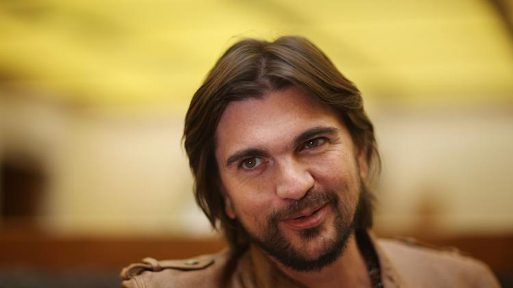"FILE - In this May 4, 2012 file photo, Colombia's singer Juanes poses for photos during an interview  to promote his new album ""Juanes MTV Unplugged,"" in Mexico City. Juanes says singer-songwriter-producer Juan Luis Guerra got him out of his comfort zone when the famed musician started rearranging his songs for his ""MTV Unplugged"" taping. The singer said the 14 songs on ""Juanes: MTV Unplugged,"" released this week, is a blend of Latin, jazz, blues, rock, folk and classic sounds.  (AP Photo/Alexandre Meneghini, file)"
