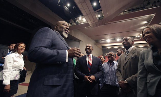 This Aug. 13, 2012 photo shows Bishop T.D. Jakes, foreground, chatting with a group of young adults he mentors at the Potters House in Dallas. Bishop Jakes work as a film producer has motivated him to mentor more young people. As producer for the remake of Sparkle staring Whitney Houston, Jakes and others see Houston&#39;s spirit of mentoring and true-to-life role in the film, in which she plays a singer trying to raise her children in the church so they avoid some of the mistakes she made during her career. (AP Photo/LM Otero)