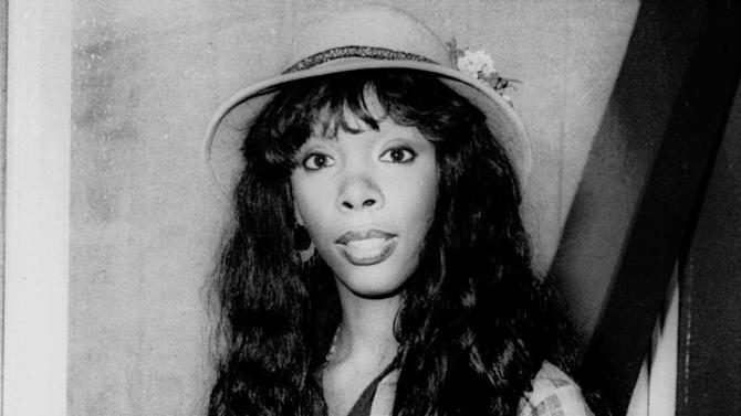 "FILE - In this Oct. 21, 1977 file photo, Donna Summer, 27, arrives at Heathrow Airport from Paris. Summer, the Queen of Disco who ruled the dance floors with anthems like ""Last Dance,"" ""Love to Love You Baby"" and ""Bad Girl,"" has died. Her family released a statement, saying Summer died Thursday, May 17, 2012. She was 63. (AP Photo/File)"