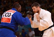 Russia&#39;s Alexander Mikhaylin (white) competes with DR Congo&#39;s Cedric Mandembo Kebika (blue) during their men&#39;s +100kg judo contest match of the London 2012 Olympic Games on August 3, at the ExCel arena in London