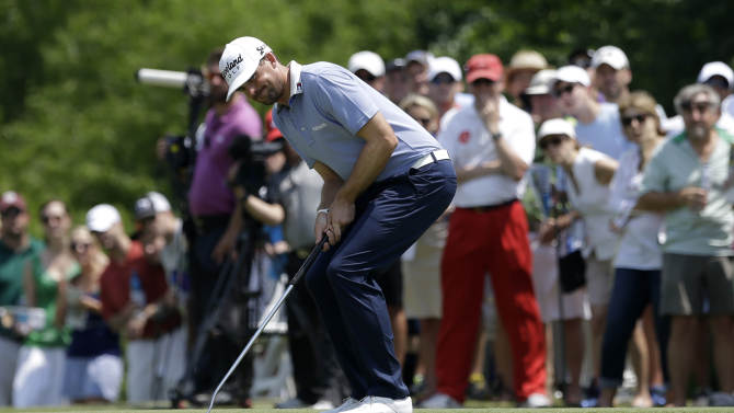 Keegan Bradley reacts to missing a putt for birdie on the second green during the third round of the Byron Nelson Championship golf tournament Saturday, May 18, 2013, in Irving, Texas. Bradley hit for par on the hole. (AP Photo/Tony Gutierrez)