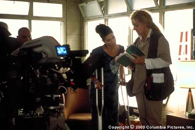 Director Betty Thomas (right) discusses a scene with star Sandra Bullock during the North Carolina-based filming of the Columbia Pictures presentation, 28 Days