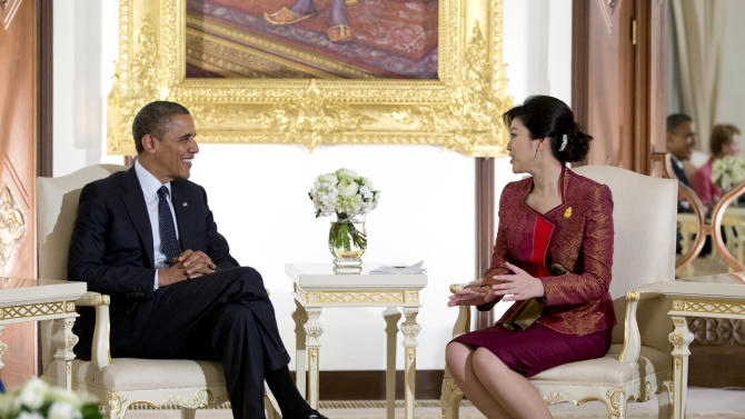 U.S. President Barack Obama, left, and Thai Prime Minister Yingluck Shinawatra talk as they are photographed before a meeting at Government House in Bangkok, Thailand, Sunday, Nov. 18, 2012. (AP Photo/Carolyn Kaster)