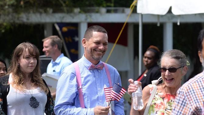 Ramon Vargas, a native of the Dominican Republic, laughs as he leaves the Naturalization Ceremony at Harmony Hall in Kinston, N.C., Saturday, July 4, 2015. (AP Photo by Zach Frailey/The Free Press via AP)