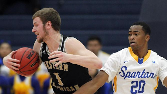 Western Michigan forward Tucker Haymond (1) spins away from San Jose State guard Isaac Thornton (20) in the first half of an NCAA college basketball second round game at the Wooden Legacy tournament in Fullerton, Calif., Friday, Nov. 28, 2014. (AP Photo/Alex Gallardo)