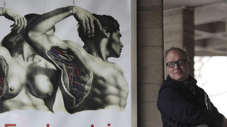 Designer Mark Tildesley poses for the photographer outside Britain's National Theatre on River Thames' South Bank ahead of the theatre's new production of Frankenstein, in London, Tuesday Jan. 25, 2011.   The show opens Tuesday  Feb. 22, 2011 at London's National Theatre and its run is all but sold out. That's partly from anticipation of what the visually inventive director Danny Boyle  working with designer Mike Tildesley, a frequent collaborator  will pull off. (AP Photo/Lefteris Pitarakis)