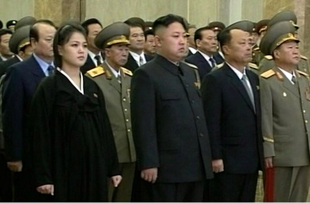 FILE - In this Dec. 17, 2012 file image made from video, North Korean leader Kim Jong Un, second from left in front row, and his wife Ri Sol Ju, left, attend a ceremony to reopen the mausoleum where h