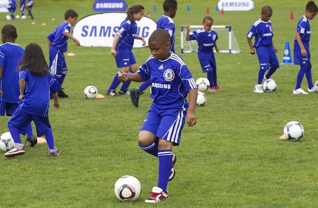 COMMERCIAL IMAGE -  Campers take part in dribbling drills during he Samsung-Chelsea FC Youth Football Camp at Starfire Sports Complex on Tuesday July 17, 2012 near Seattle. (Photo by Stephen Brashear/