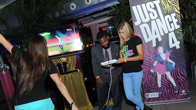 COMMERCIAL IMAGE - A guest learns about Just Dance 4 for Nintendo's Wii U at Ubisoft's NYC Dance Party showcasing their holiday line-up of dance video games, Tuesday, Aug. 21, 2012, at New York's Empire Hotel. (Photo by Diane Bondareff/Invision for Ubisoft/AP Images)