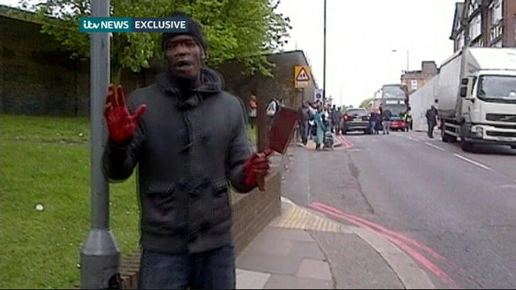 Still image of Adebolajo speaking after the murder of soldier Rigby in Woolwich