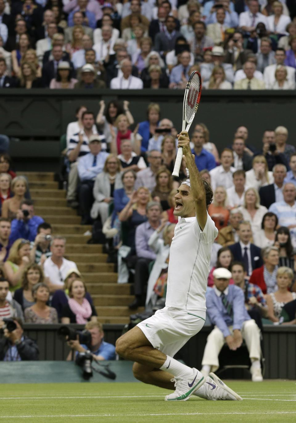 Roger Federer of Switzerland celebrates winning the men's singles final against Andy Murray of Britain at the All England Lawn Tennis Championships at Wimbledon, England, Sunday, July 8, 2012. (AP Photo/Kirsty Wigglesworth)