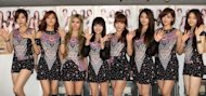 South Korean girl band T-ara pose after a concert in Tokyo, July 26, 2012. The popular South Korean girl band has stirred controversy with the surprise decision to shed one of its members, a move which sparked an Internet protest campaign backed by some 330,000 people