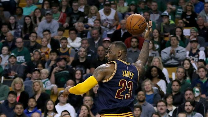 LeBron James of the Cleveland Cavaliers keeps the ball in bounds in the second quarter of Game Four during the first round of the NBA playoffs on April 26, 2015 in Boston