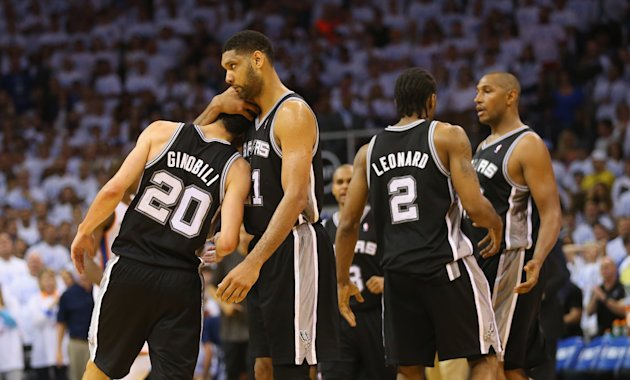 OKLAHOMA CITY, OK - MAY 31: Tim Duncan #21 of the San Antonio Spurs hugs teammate Manu Ginobili #20 after Ginobili hit a three-point shot against the ...