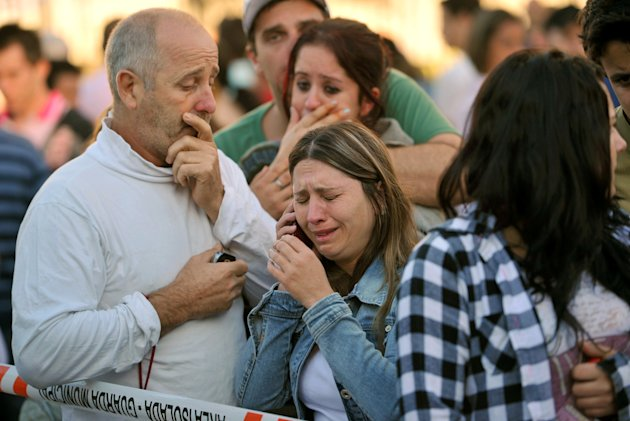 Relatives of victims react as they wait for news in fron of the Kiss nightclub in Santa Maria city,  Rio Grande do Sul state, Brazil, Sunday, Jan. 27, 2013.  According to police more than 200 died in