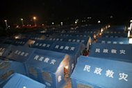 Makeshift tents are set up at an emergency relief centre in the town square in Yiliang on September 8. Rescuers battled blocked roads and downed communications, searching for survivors after the death toll from twin earthquakes that struck southwestern China rose to 80