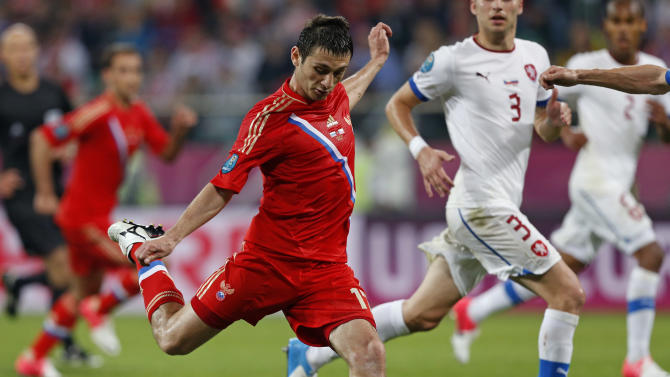 Russia's Alan Dzagoyev fires a shot and scores his side's third goal during the Euro 2012 Group A soccer match between Russia and Czech Republic, in Wroclaw, Poland, Friday, June 8, 2012.  (AP Photo/Petr David Josek)