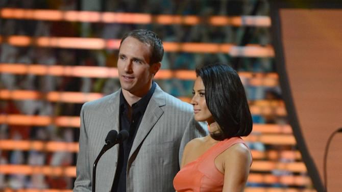 From left, Drew Brees of the New Orleans Saints and Actress Olivia Munn at the 2nd Annual NFL Honors on Saturday, Feb. 2, 2013 in New Orleans. (Photo by Jordan Strauss/Invision/AP)
