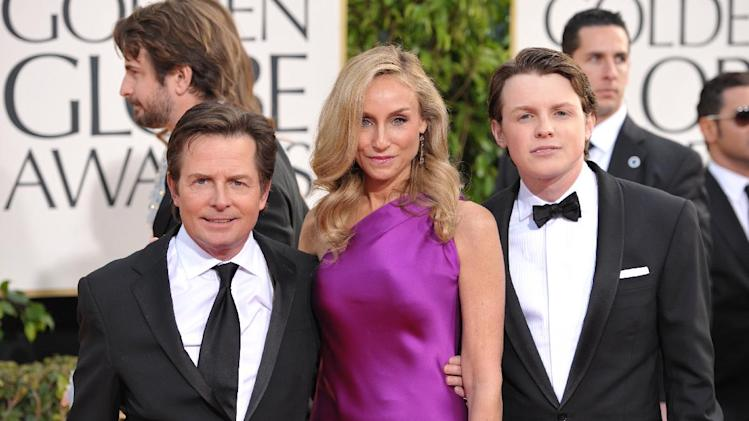 Actors Michael J. Fox, Tracy Pollan and Sam Fox arrive at the 70th Annual Golden Globe Awards at the Beverly Hilton Hotel on Sunday Jan. 13, 2013, in Beverly Hills, Calif. (Photo by John Shearer/Invision/AP)