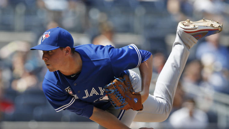 Toronto Blue Jays starting pitcher Aaron Sanchez (41) delivers in the eighth inning of a baseball game at Yankee Stadium in New York, Sunday, July 27, 2014. (AP Photo/Kathy Willens)