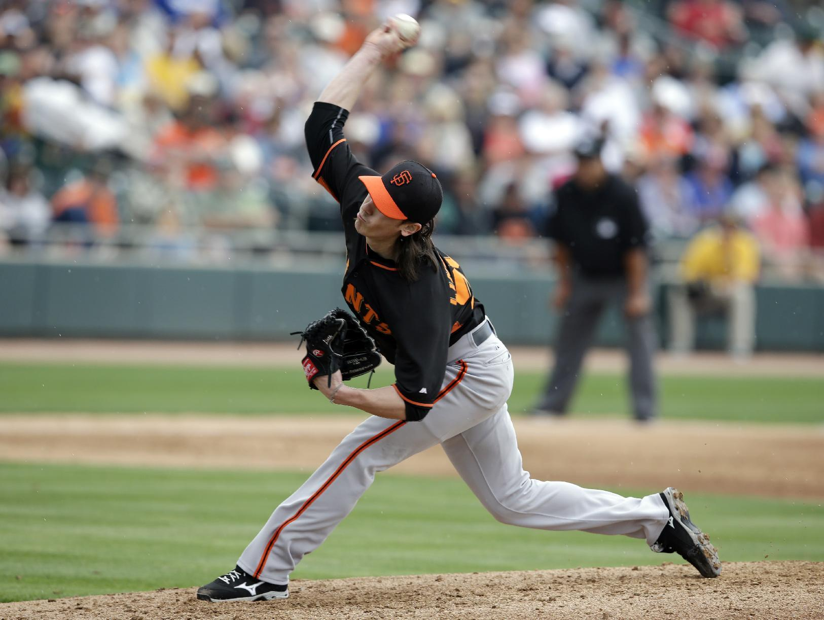 Bumgarner hit hard in spring debut, Athletics beat Giants