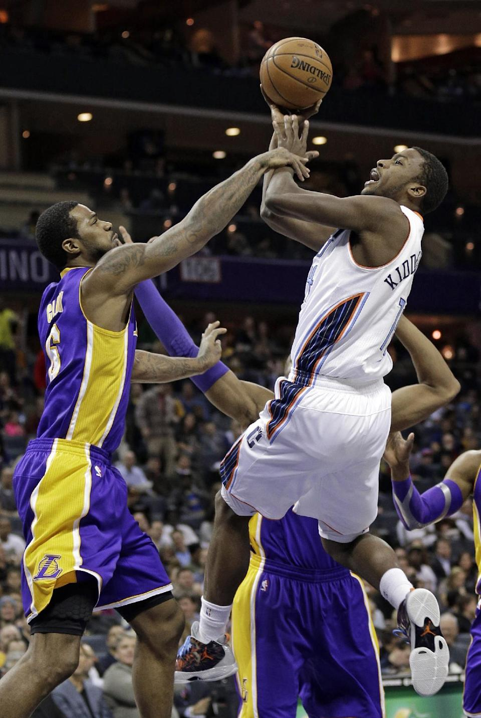 Charlotte Bobcats' Michael Kidd-Gilchrist, right, is fouled by Los Angeles Lakers' Earl Clark, left, during the first half of an NBA basketball game in Charlotte, N.C., Friday, Feb. 8, 2013. (AP Photo/Chuck Burton)