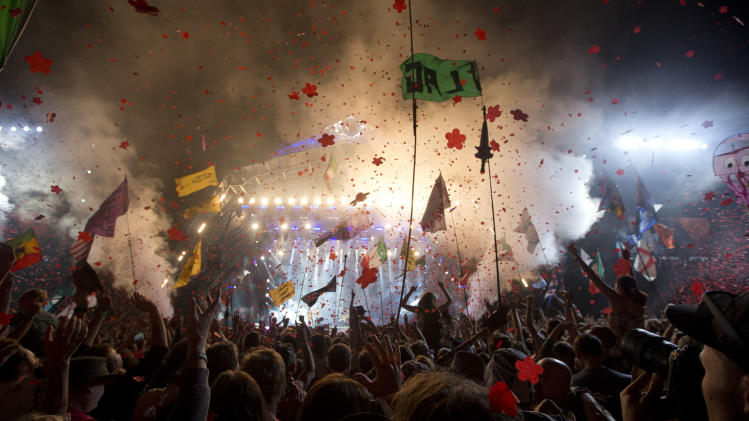 The crowd watches British band the Rolling Stones perform on the Pyramid main stage at Glastonbury, England, Saturday, June 29, 2013. Thousands of music fans have arrived for the festival to see headliners, Arctic Monkeys, Mumford and Sons and the Rolling Stones.(Photo by Joel Ryan/Invision/AP)