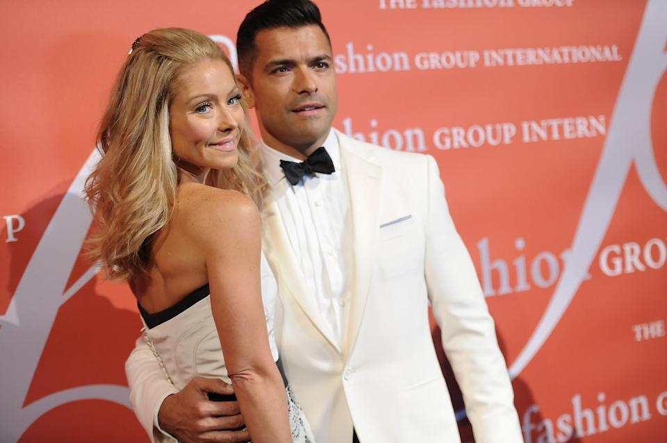 "Television personality Kelly Ripa and her husband Mark Consuelos attend the 29th Annual ""Night Of Stars"" presented by The Fashion Group International at Cipriani Wall Street on Thursday Oct. 25, 2012 in New York. (Photo by Evan Agostini/Invision/AP)"
