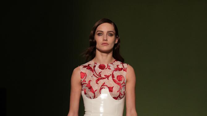 A model performs during the Jonathan Saunders autumn/winter 2013 London Fashion Week show at The Royal Exchange in London, Sunday Feb. 17, 2013. (AP Photo / Yui Mok, PA) UNITED KINGDOM OUT - NO SALES - NO ARCHIVES