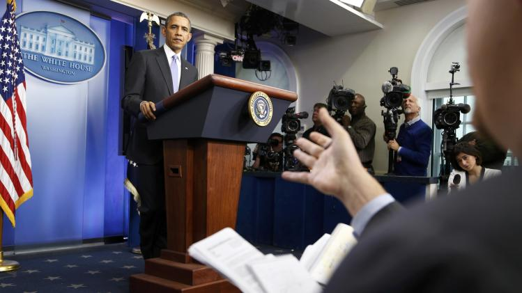 U.S. President Barack Obama holds his year-end news conference in the press briefing room at the White House in Washington