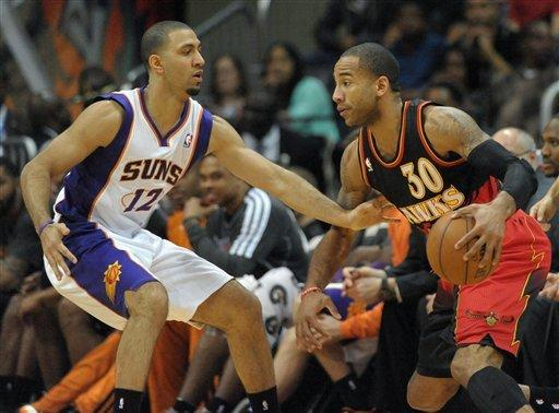 Smith has double-double, Hawks beat Suns, 107-94