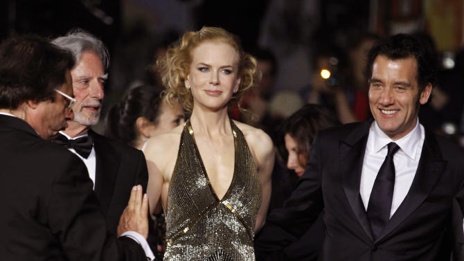 Director Phillip Kaufman, second left, actress Nicole Kidman, center and Clive Owen arrive for the screening of Hemingway and Gellhorn at the 65th international film festival, in Cannes, southern France, Friday, May 25, 2012. (AP Photo/Joel Ryan)