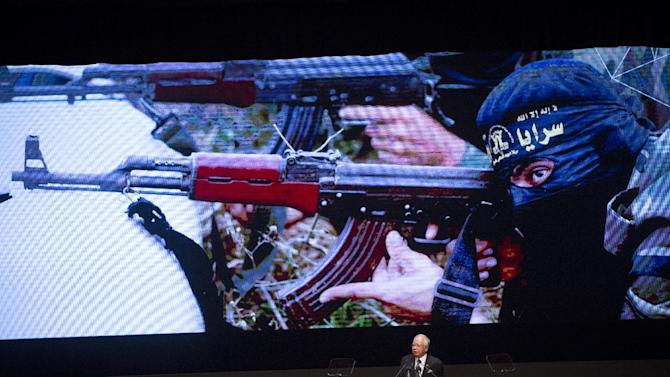 Malaysia's Prime Minister Najib Razak talks about threats of terrorism at his opening speech during the opening ceremony for the 26th ASEAN Summit in Kuala Lumpur, Malaysia, on Monday, April 27, 2015. (AP Photo/Vincent Thian)