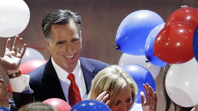 Republican presidential nominee Mitt Romney watches as balloons fall around him and his wife Ann during the Republican National Convention in Tampa, Fla., on Friday, Aug. 31, 2012. (AP Photo/Patrick Semansky)